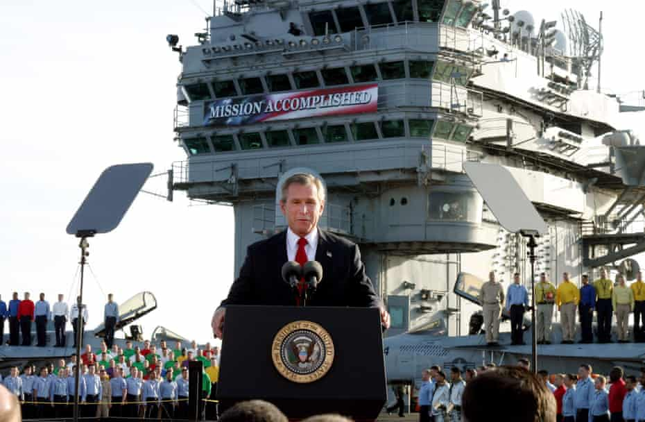 President George W Bush aboard the USS Abraham Lincoln off the California coast in May 2003.