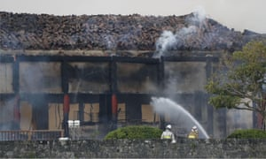 Firefighters try to extinguish a fire at Shuri Castle, listed as a World Heritage site, in Naha on the southern island of Okinawa.
