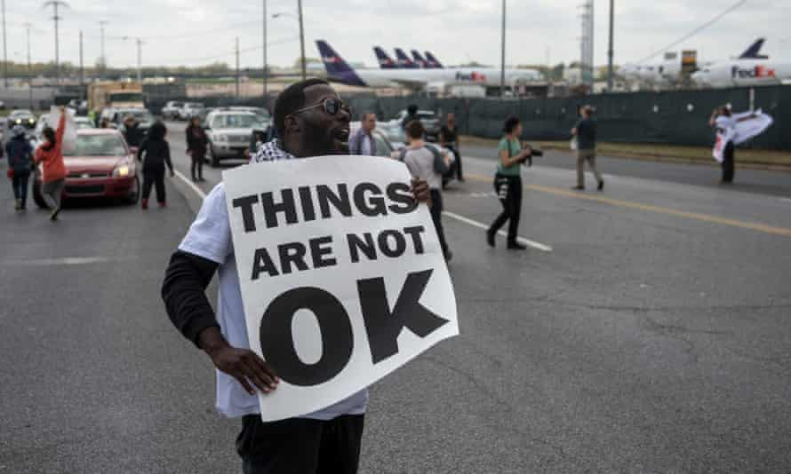 A demonstration organizer, Keedran Franklin, stands in front of an employee entrance at the FedEx hub at Memphis international airport.