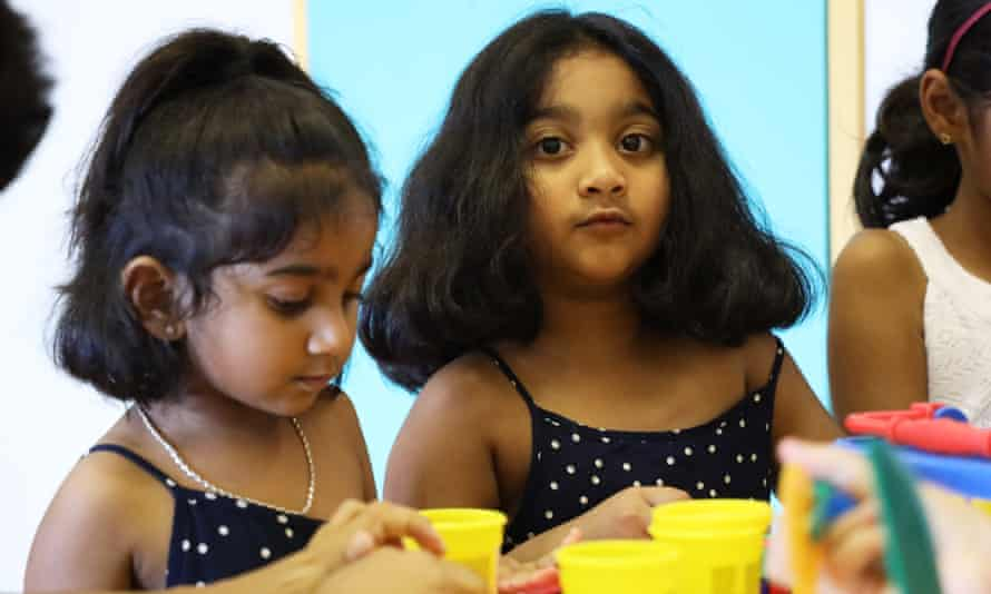 Tharunicaa aged 3 (left), and Kopika, aged 5 in the visitors room at the Christmas Island detention centre.