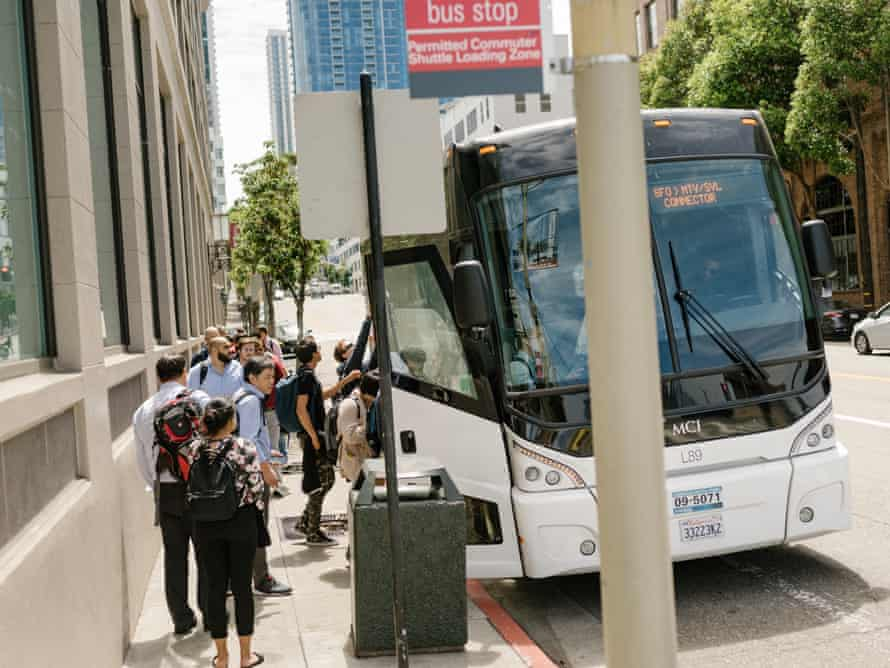 Workers near Google's San Francisco offices catch a bus headed to Mountain View, home of the company's main campus.
