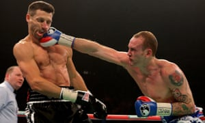 George Groves (right) lands an impressive right-hand jab on Carl Froch