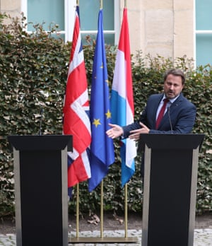 Xavier Bettel gestures to the empty space where Boris Johnson was originally meant to be joining him for a news conference after their talks in Luxembourg.