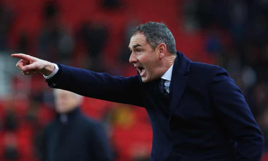 Swansea City manager Paul Clement barks out instructions during their Premier League match against Stoke City in December 2017.