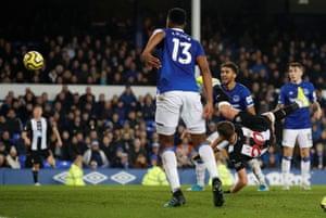 Newcastle United's Florian Lejeune scores with an acrobatic shot.