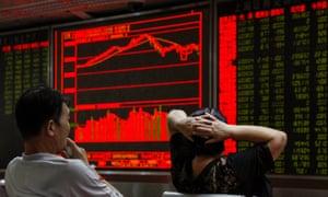 Chinese investors look at stock market board
