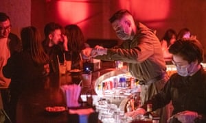 Bartenders wearing face masks at 44KW nightclub in Shanghai