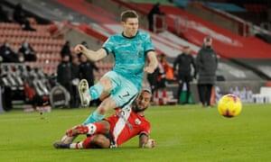 Southampton's Theo Walcott tackles Liverpool's James Milner.