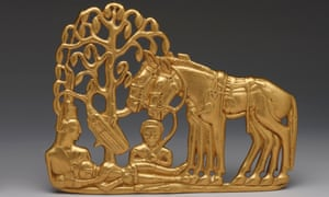 A gold belt plaque of a Scythian funerary scene.