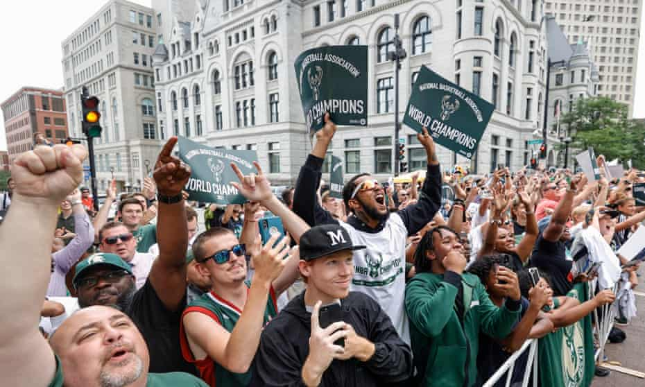 Fans celebrate during the Milwaukee Bucks victory parade on 22 July.