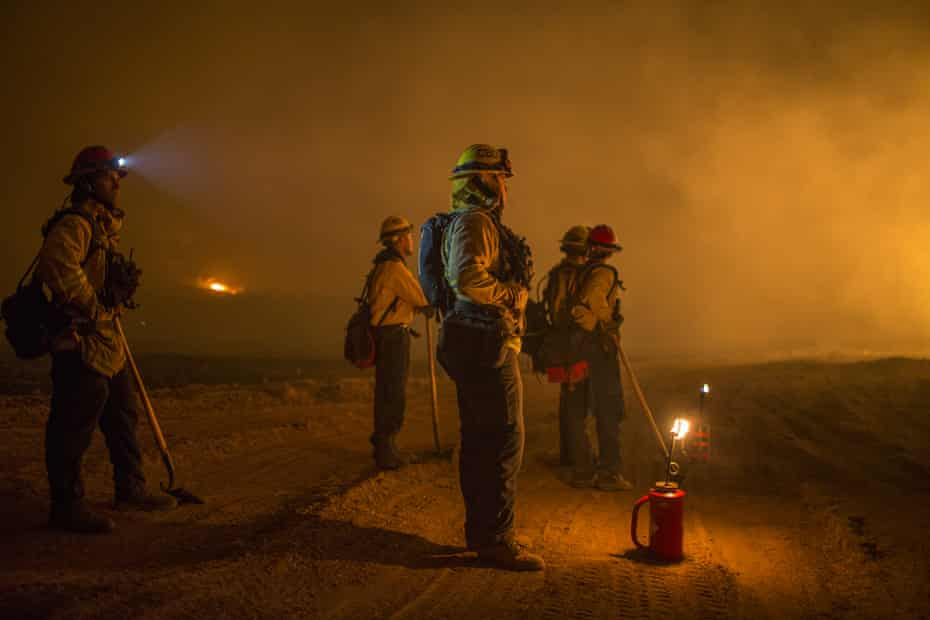 Firefighters tackle a major blaze near Ojai, California, in 2017. A class action lawsuit is being brought on behalf of female firefighters in the state.