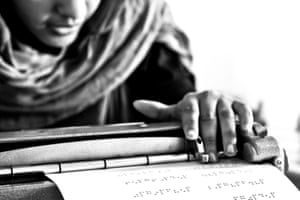 A Sahrawi student learns to read in braille