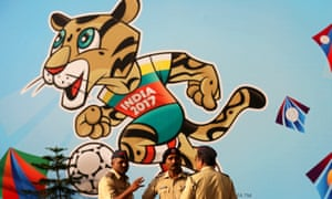 Indian police in front of the official mascot of the Fifa under-17 World Cup 2017, a clouded leopard called Kheleo, at the DY Patil stadium in Mumbai.