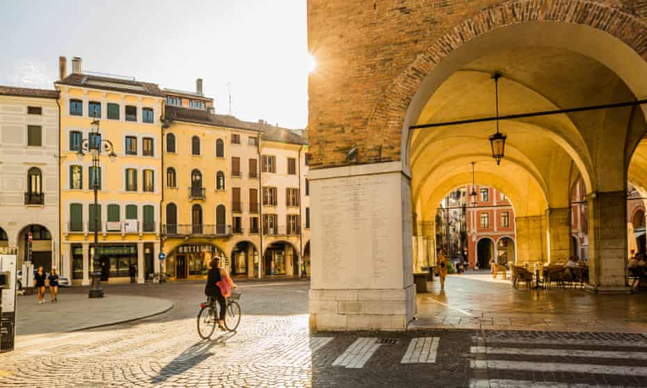 A cyclist in Piazza dei Signori.