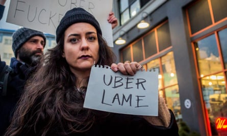 Dozens protest outside Uber's headquarters in Long Island City in February.