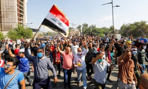 Demonstrators on the march in Baghdad yesterday.