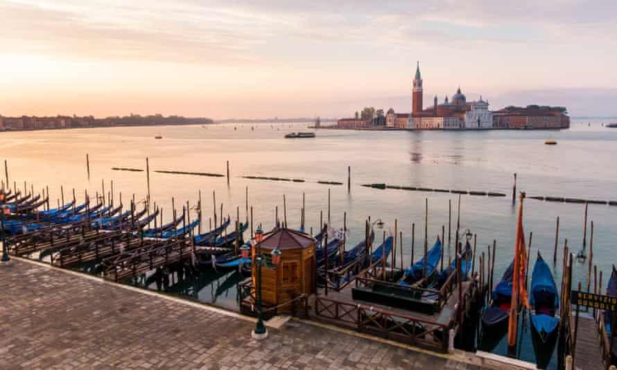 Gondolas moored in a deserted Venice