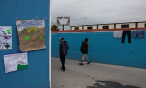Teenage boys make their way at the yard of a migrant shelter for unaccompanied minors in Tijuana, Mexico, 5 December 2018.