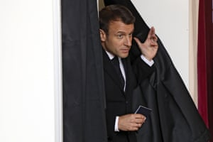 French president, Emmanuel Macron, exits a voting booth in Le Touquet, northern France