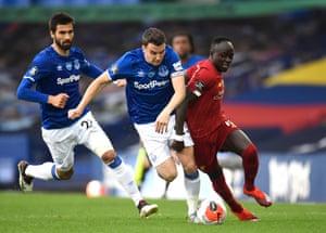 Seamus Coleman of Everton and Sadio Mane of Liverpool battle for possession.
