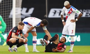 Gary Cahill of Crystal Palace checks on Joshua King of AFC Bournemouth following a tackle.
