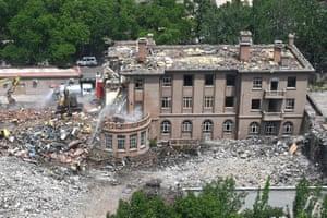 Beijing, China Workers demolish the former US embassy