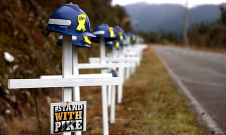 White crosses and saftey helmets are pictured on the access road to the Pike River Mine