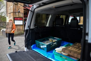 A volunteer collects food donations for NHS staff in Glasgow.