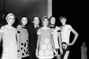 Cardin is seen with fashion models after his spring/summer 1967 show in Paris