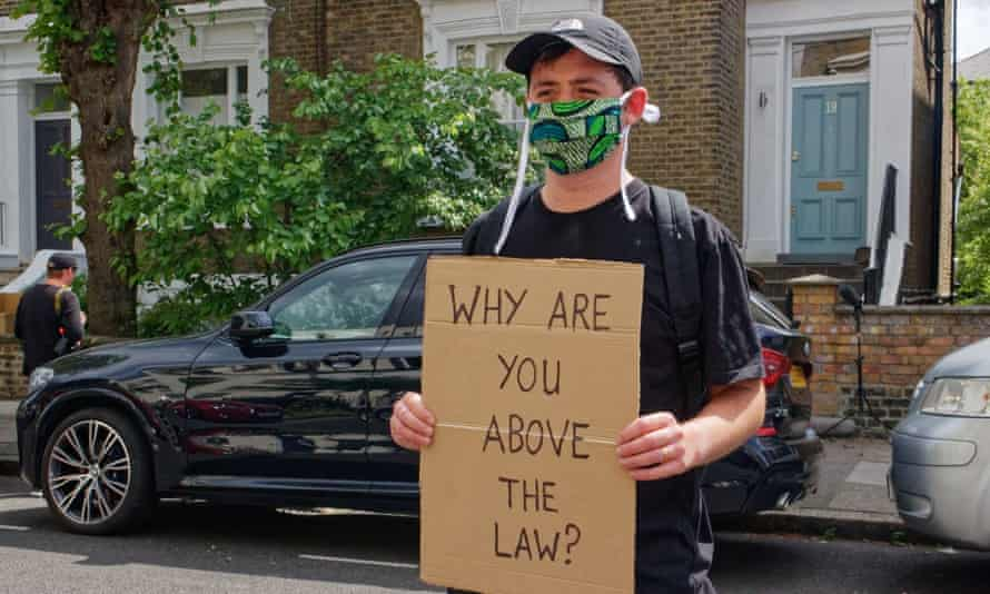 A protester outside Dominic Cummings' home in London.