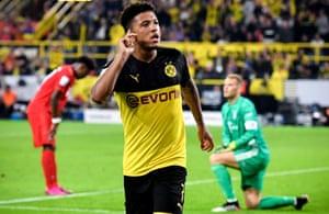 Jadon Sancho celebrates after doubling Dortmund's lead.