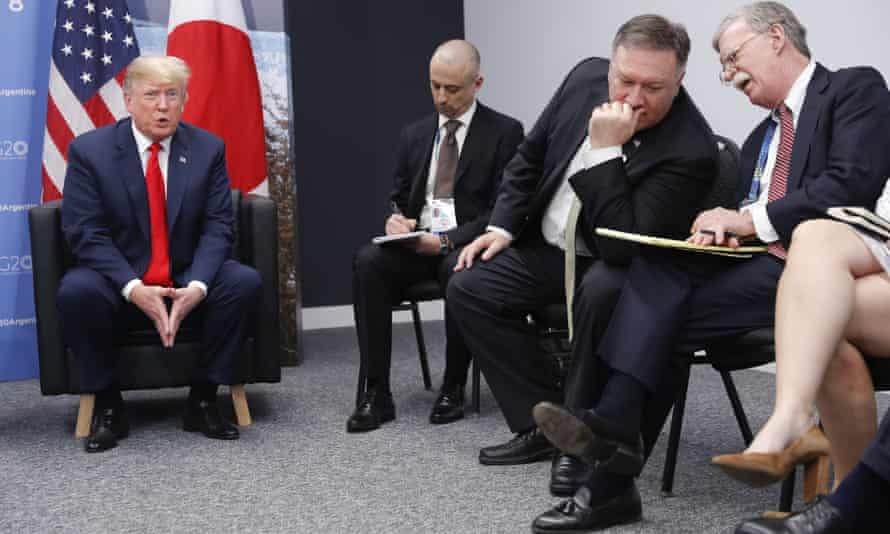 John Bolton, far right, talks to secretary of state Mike Pompeo as Donald Trump looks on.