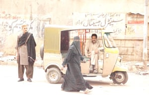 Ustad Saami (left) on the street in Karachi.
