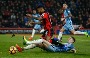 Joshua King is tackled by John Stones.