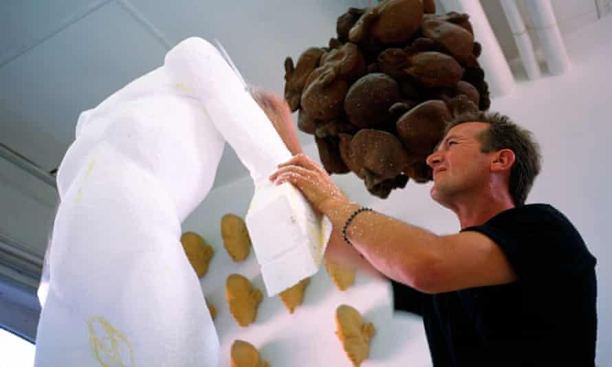 """Artist Johannes Speder at work on his sculpture """"Der Blumenriecher"""" at his studio in the German city of Hamburg."""