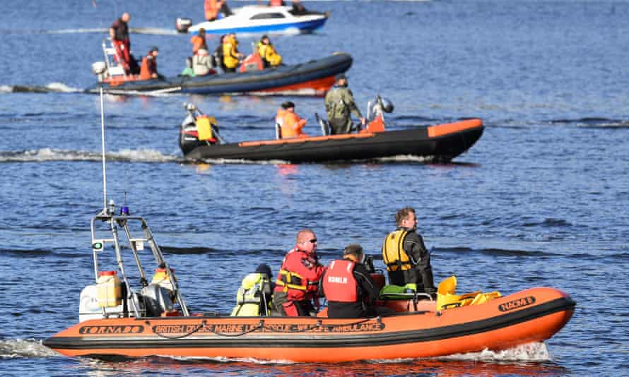Boats are seen attempting to herd Northern Bottlenose whales from the Gare Loch through Rhu Narrows into the open sea ahead of a military exercise starting in the region on 1 October 2020 in Garelochhead, Argyll and Bute, Scotland.