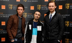 Adam Deacon with Eddie Redmayne and Tom Hiddleston, who he beat to the Bafta rising star award in 2012. Photograph: Ben Pruchnie/Getty Images