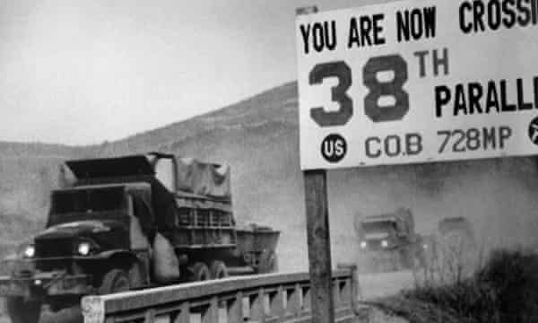 United Nations forces cross the 38th parallel while withdrawing from Pyongyang, the North Korean capital, 1950.