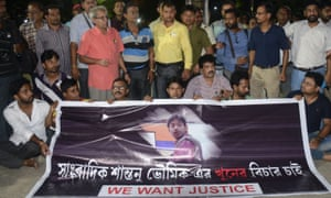 Indian journalists at a road blockade set up over the killing of journalist Shantanu Bhowmick in Agartala.