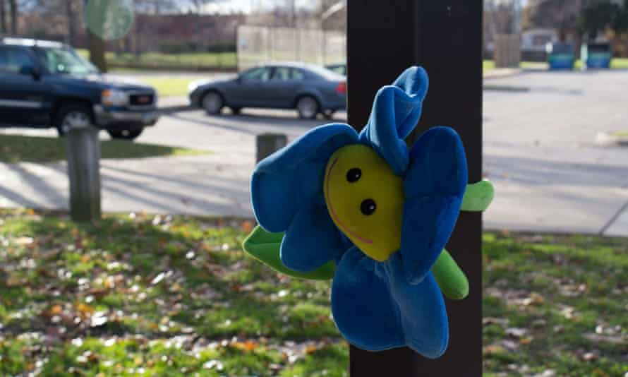 """A stuffed animal is fixed to the pilar of a gazebo at Cudell Commons Park in Cleveland, Ohio, November 24, 2014 where a memorial was set up for Tamir Rice, a 12-year-old boy shot by police on November 23. The chief of police in the US city of Cleveland on Monday defended the conduct of the officer who fatally shot the 12-year-old who was wielding a replica handgun. Tamir Rice died in hospital early Sunday after two police officers, responding to a 911 emergency call, confronted the African-American youngster at a recreation center. Cleveland police chief Calvin Williams said the officer, whose name or racial group he did not disclose, and who has been placed on administrative leave, was """"broken up about this."""" But he stood by the officer's conduct, saying """"he had to protect himself"""" in the face of what appeared to be, in the heat of the moment, to be a genuine firearm. AFP PHOTO JORDAN GONZALEZJORDAN GONZALEZ/AFP/Getty Images"""