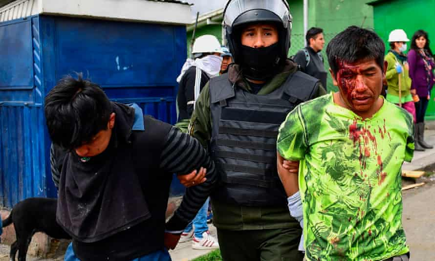 Morales supporters being arrested in La Paz