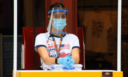 Woman wearing mask and gloves