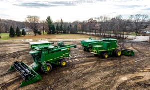 John Deere combines in a harvested soybean field in Round Lake Heights, Illinois in November. The job cuts have come as demand for farming equipment shrinks