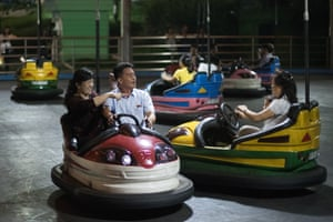 North Koreans play on the dodgems at Kaeson Youth Park in Pyongyang.