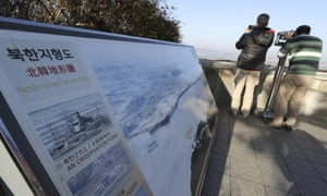 A visitor uses binoculars to see the North from the unification observatory in Paju, South Korea, on Tuesday.
