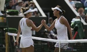 Simona Halep shakes hands with Peng Shuai of China after winning 6-4, 7-6 (7).
