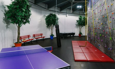 The top level features recreational options including table tennis and a rock climbing wall.