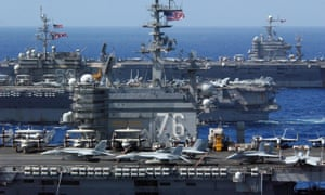 US aircraft carriers the USS Ronald Reagan (CVN 76), USS Kitty Hawk (CV 63) and USS Abraham Lincoln (CVN 72) sail in formation near Guam. The navy has outlined an ambitious goal of meeting half its energy needs from alternative sources by 2020.
