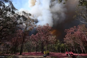Fire and rescue officers watch the Gospers Mountain fire near Colo Heights, Australia.