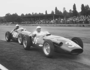 Race leader Stirling Moss is pushed to the pits by teammate Luigi Piotti after his Maserati 250F ran out of fuel.